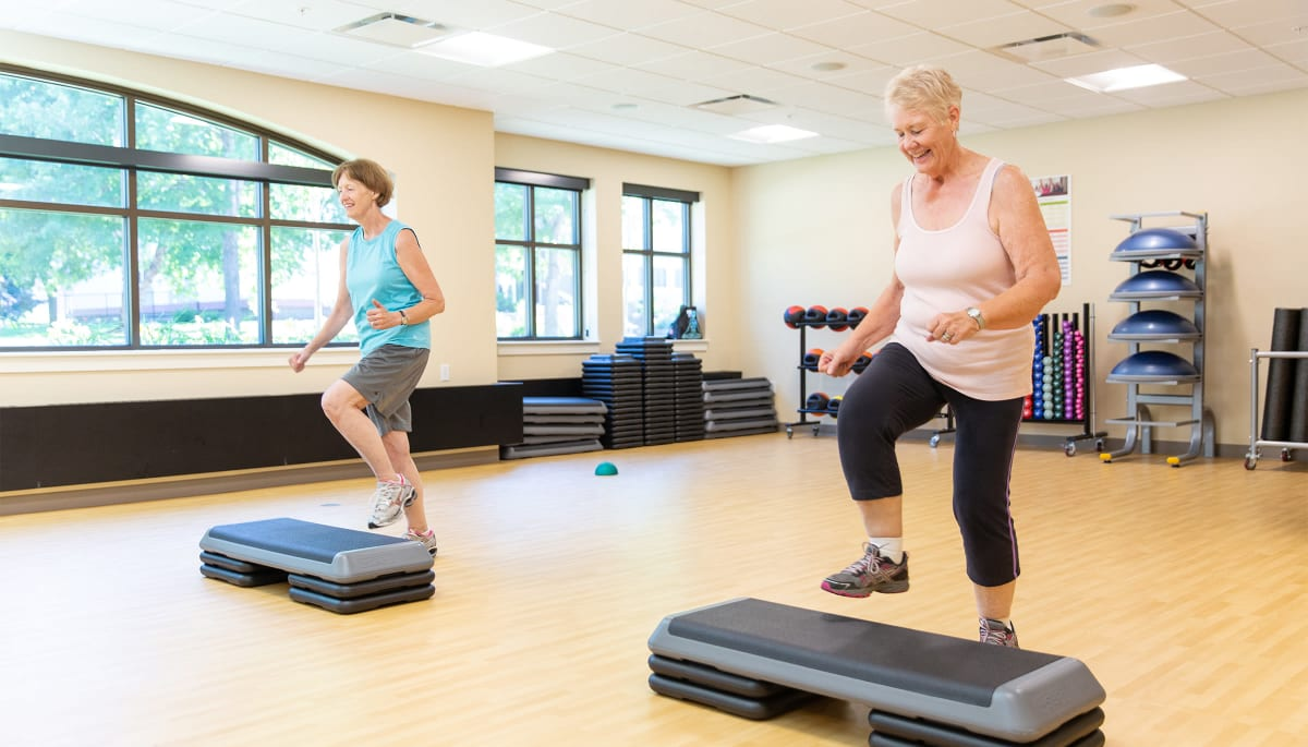 senior residents taking a fitness class at Touchmark at All Saints