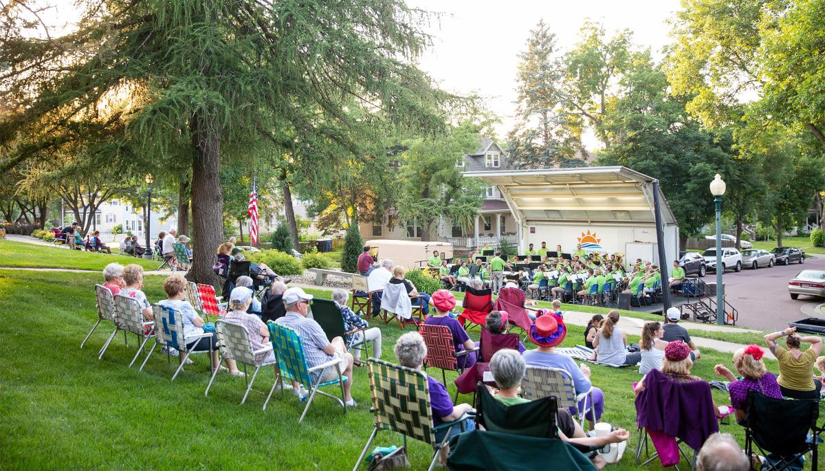 residents enjoying an outdoor concert