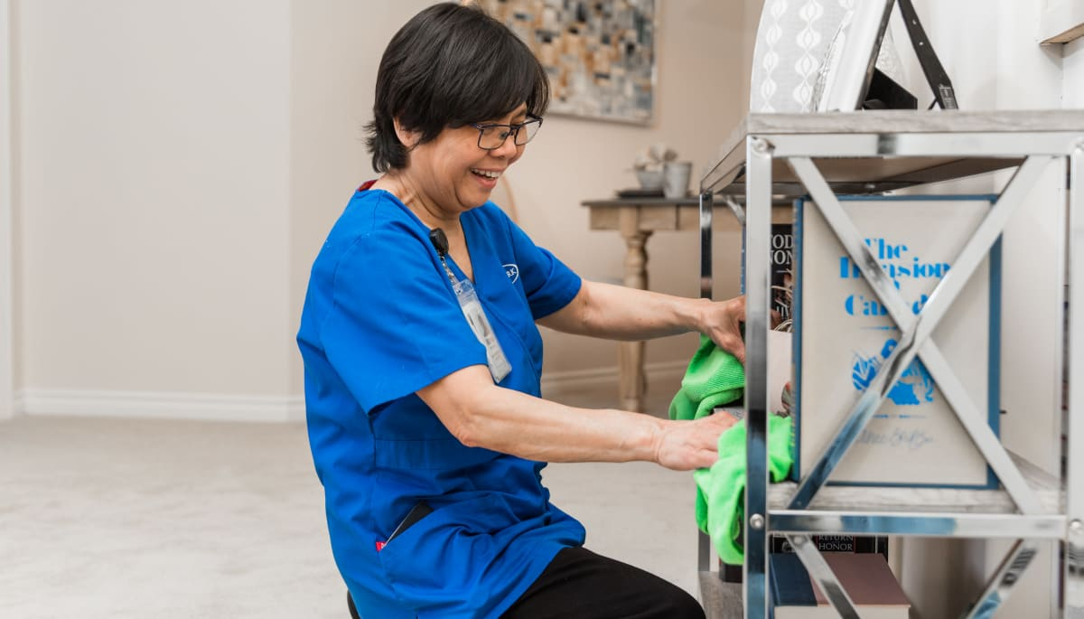 Caregiver cleaning at Touchmark at Wedgewood in Edmonton, Alberta
