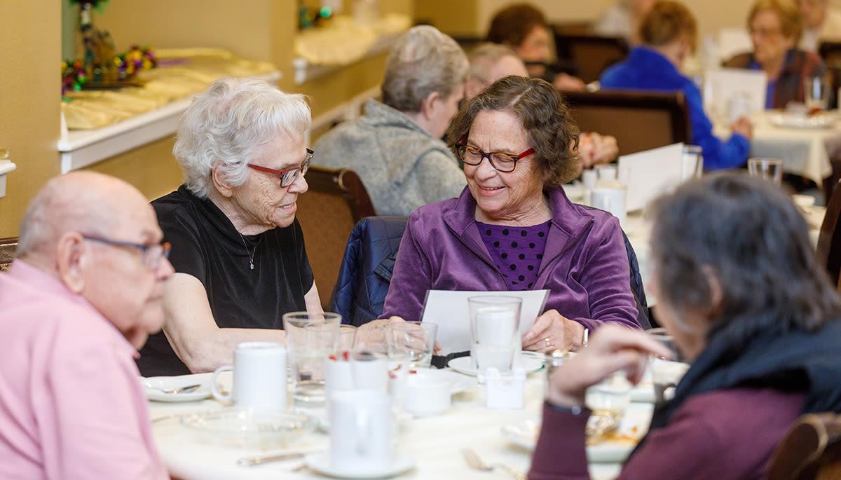 senior residents enjoying dinner