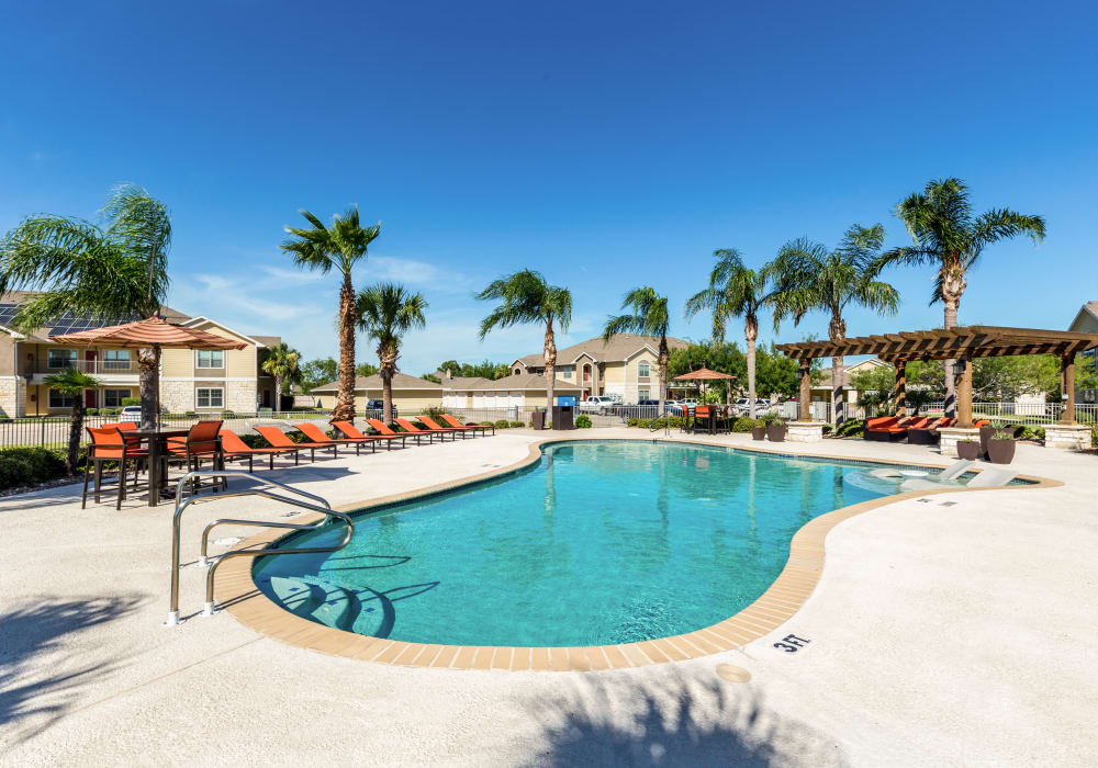 Enjoy a sparkling swimming pool at Pavilions at Northshore in Portland, Texas