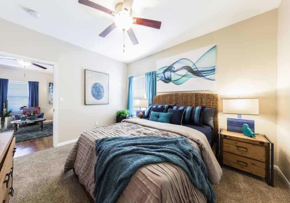 Enjoy a well-decorated bedroom at Pavilions at Northshore in Portland, Texas