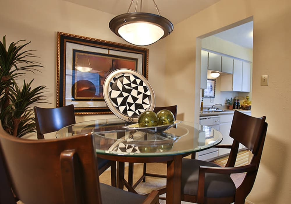 Dining room table at Willow Oaks Apartments in Bryan, Texas