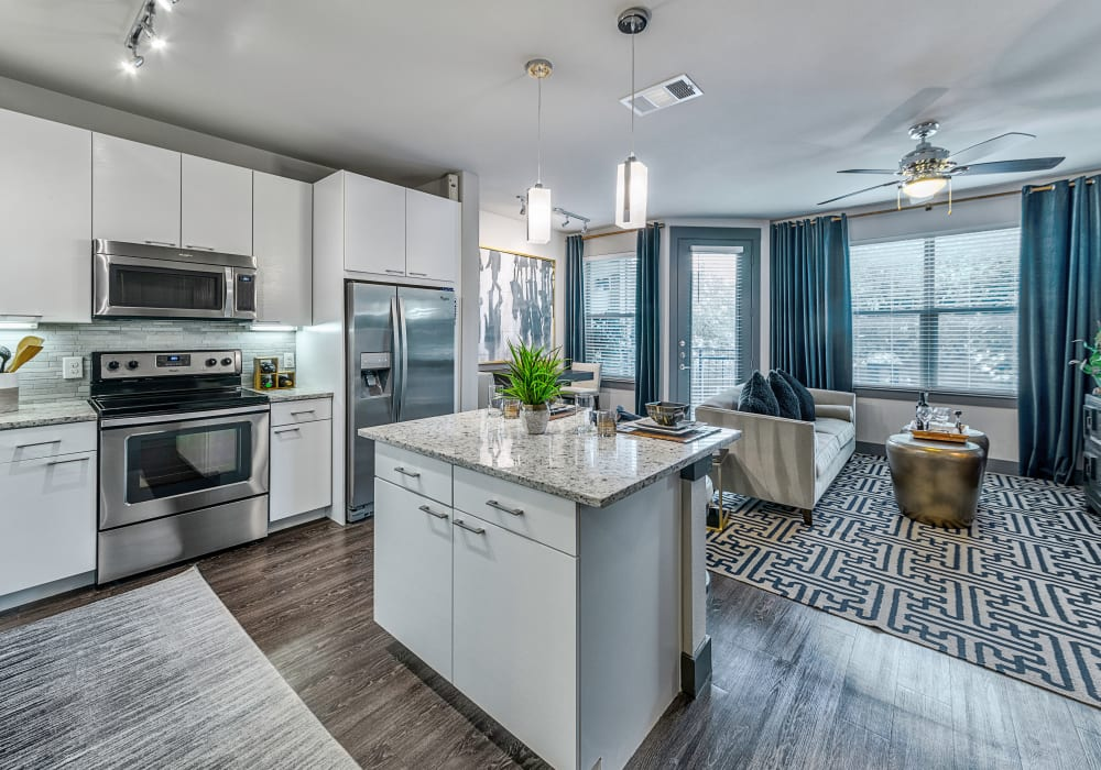 Modern kitchen and living room at Axis at Wycliff in Dallas, Texas