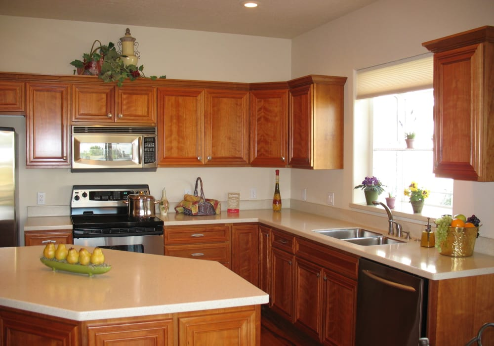 A kitchen in an apartment at Touchmark at Meadow Lake Village in Meridian, Idaho