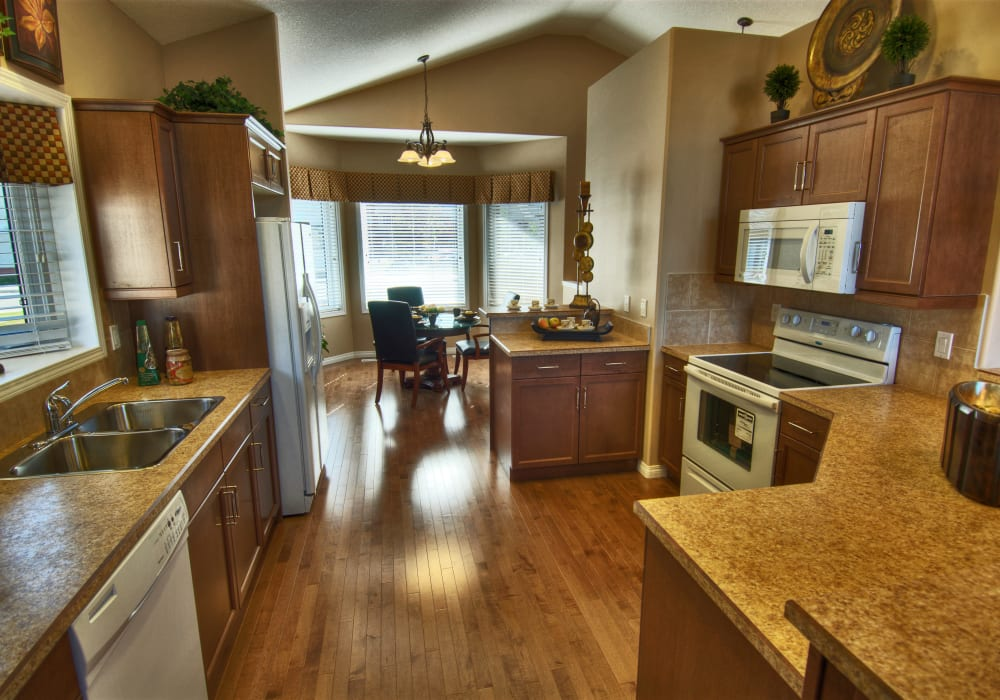 A kitchen in an apartment at Touchmark at Wedgewood in Edmonton, Alberta