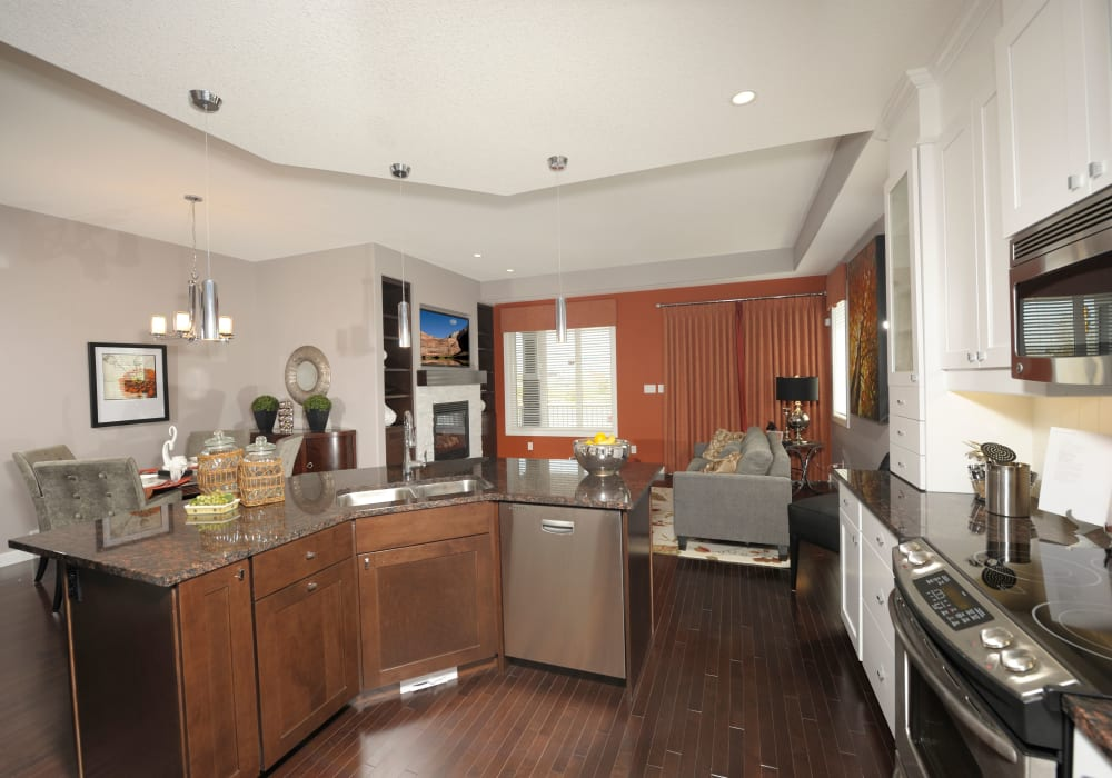 Kitchen, dining room and living room in a cottage at Touchmark at Wedgewood in Edmonton, Alberta
