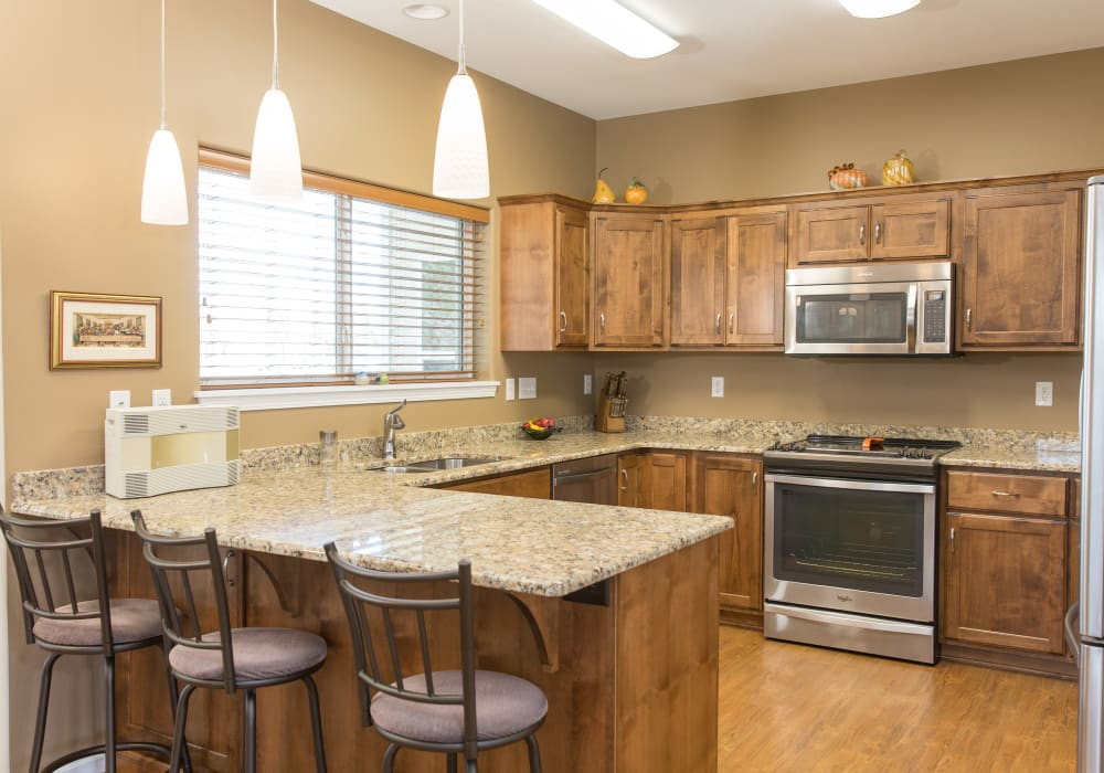 A kitchen in an apartment at Touchmark at Harwood Groves in Fargo, North Dakota