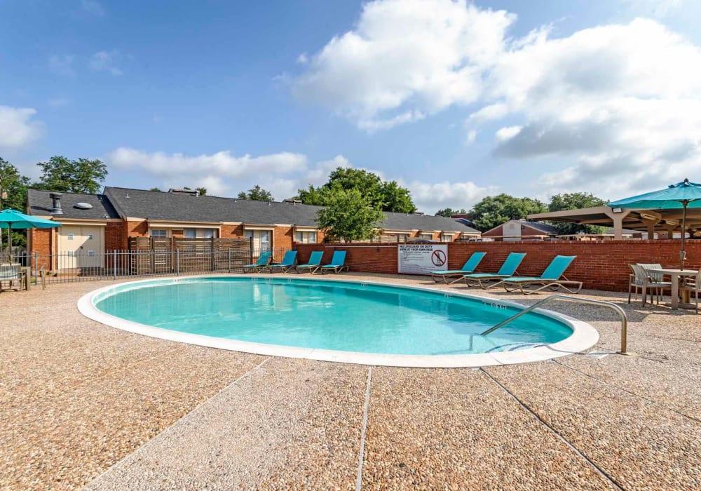 Lounge by the pool at Willow Oaks Apartments