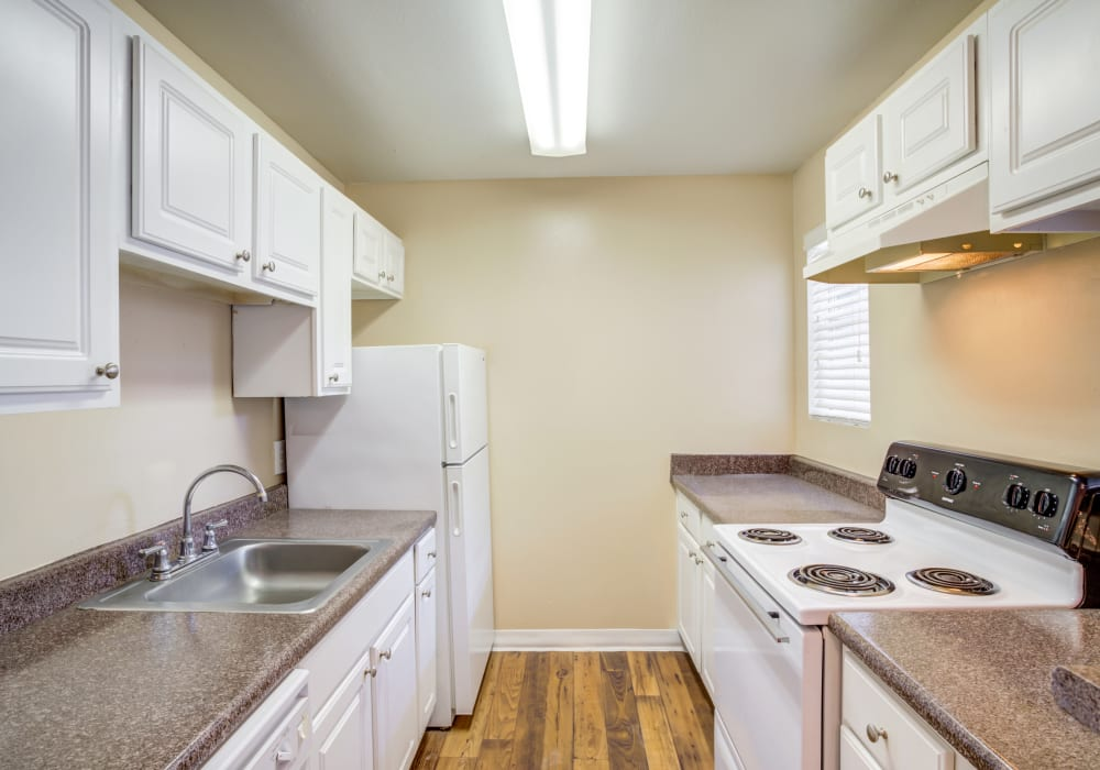 Kitchen at Woodcreek Apartments in Huntsville, Texas