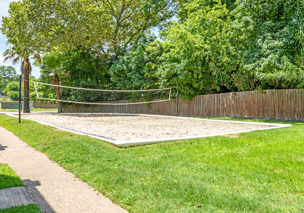 Outdoor volleyball available at Woodcreek Apartments in Huntsville, Texas