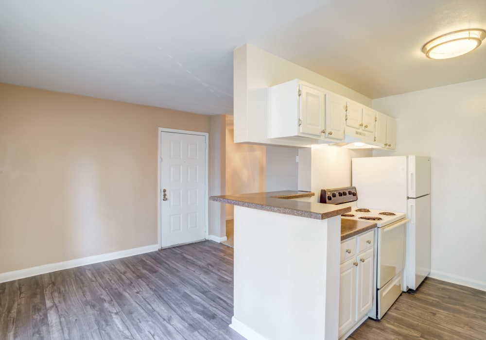 Woodcreek Apartments offers a Kitchen in Huntsville, Texas