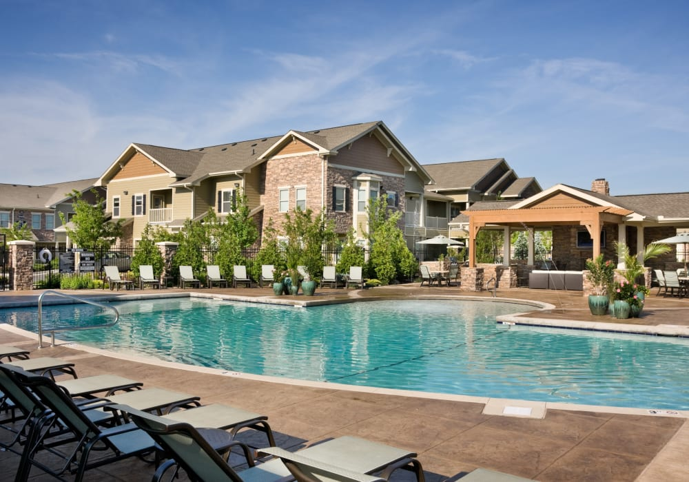 Seating by the pool at The Sovereign at Overland Park in Overland Park, Kansas