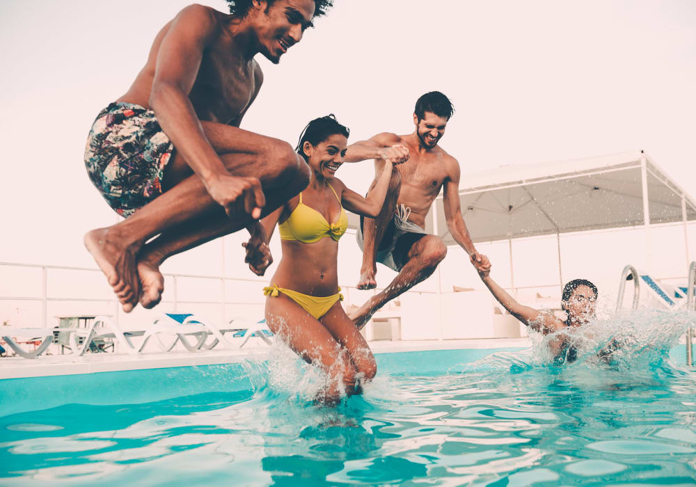 Residents hopping into the pool at Hacienda Club in Jacksonville, Florida
