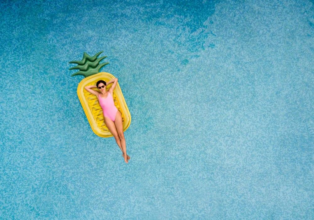 Resident floating in Ocean Park of Ponte Vedra's swimming pool in Jacksonville Beach, Florida