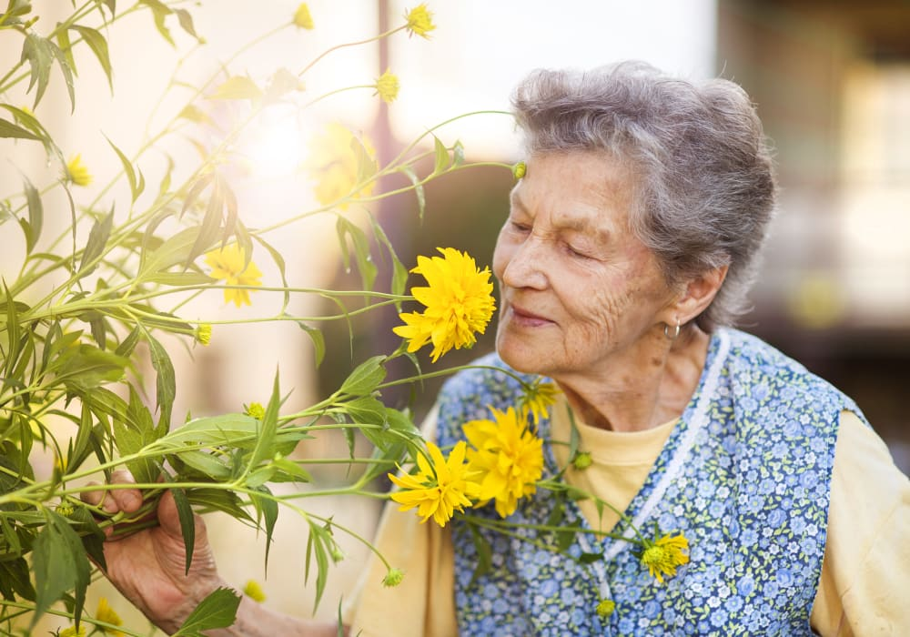 Memory Care resident gardening at Autumn Grove Cottage at Katy in Katy, Texas