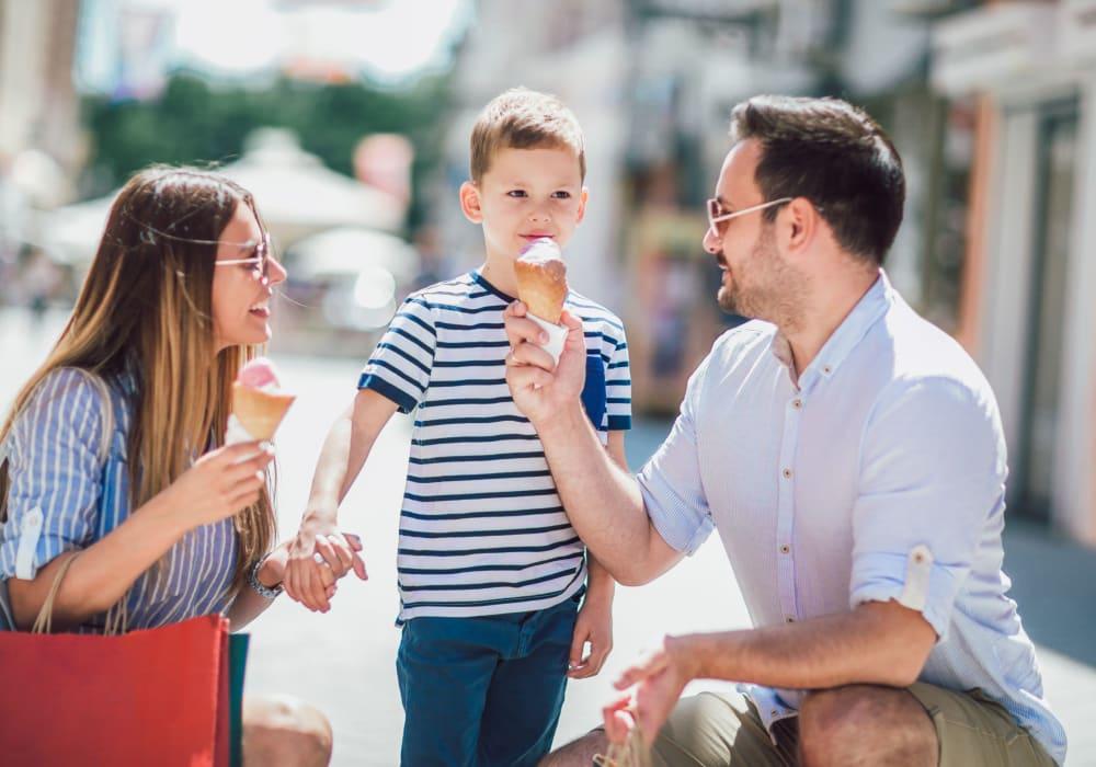 Happy family enjoying ice cream in Millsboro, Delaware near Brandywine Apartments