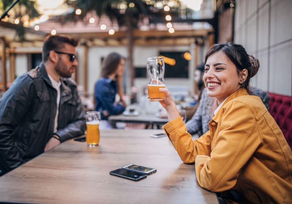 Friends enjoying beverages in Cambridge, Maryland near Parkside Village