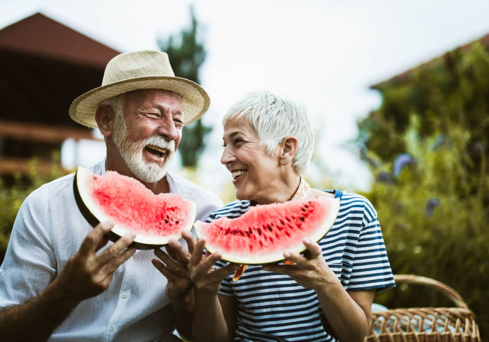 A couple eating watermelon at Little Creek Apartments in Laurel, Delaware