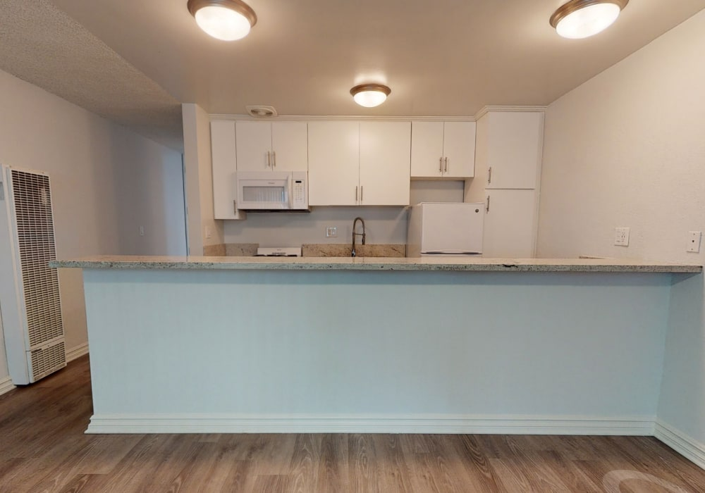 View a virtual tour of our studio apartments with an L-shaped kitchen island at Casa Granada in Los Angeles, California