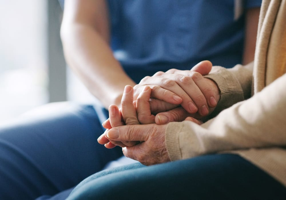 Holding hands at Flagstone Senior Living in The Dalles, Oregon.