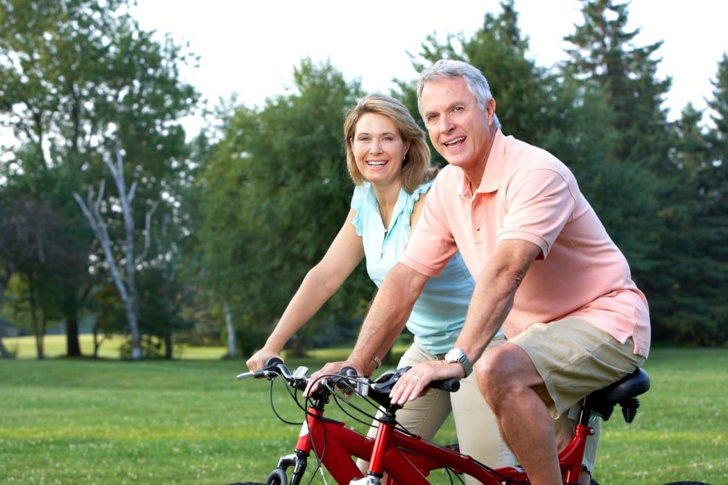 Couple on a bike ride in Riverside near Stonecrest Senior Living