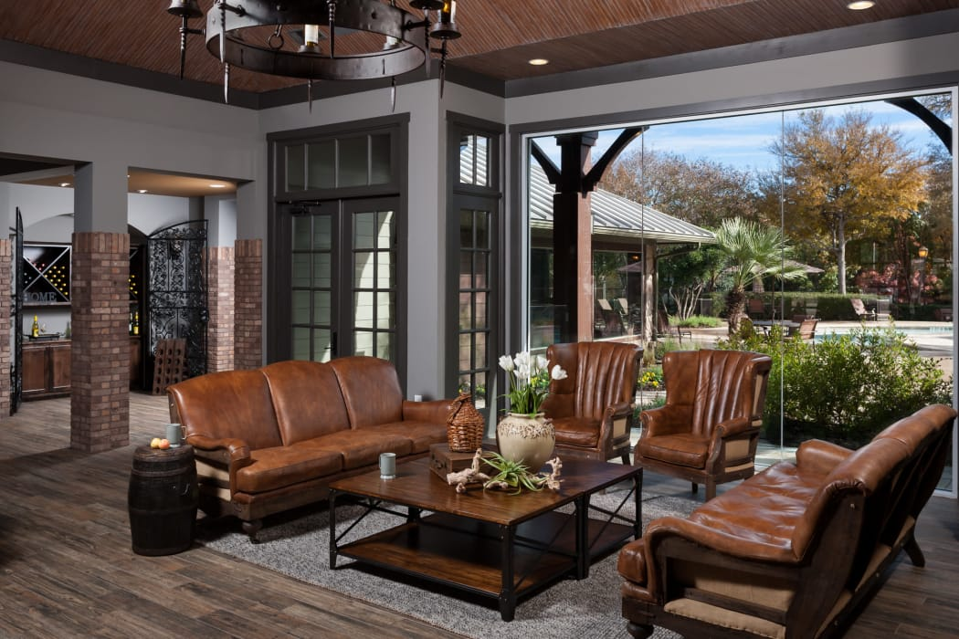Living room with a roll-up door at Tintara at Canyon Creek in Austin