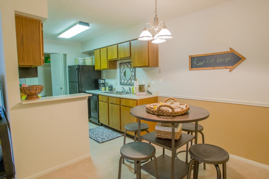 Dining table and kitchen at Cedar Glade Apartments in Tulsa, Oklahoma