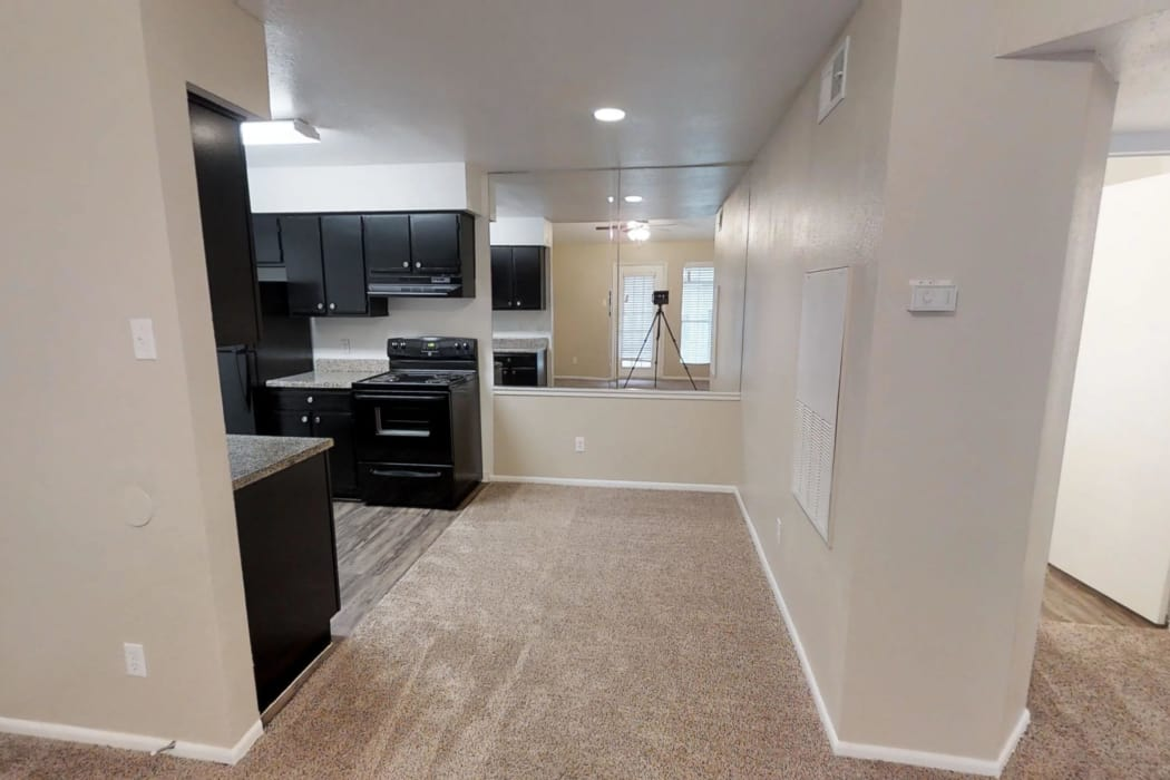 Westport Apartments offers a spacious living room in Angleton, Texas