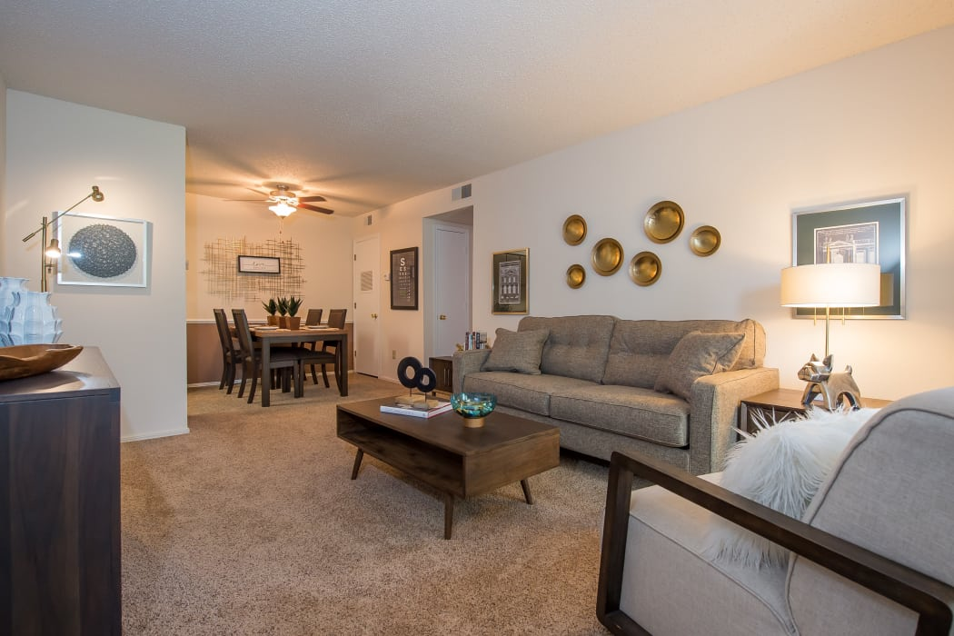 Bright living room at Raintree Apartments in Wichita, Kansas