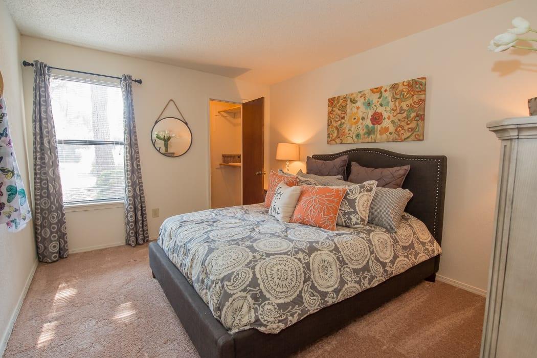 Bright bedroom at Sunchase Ridgeland Apartments in Ridgeland, Mississippi