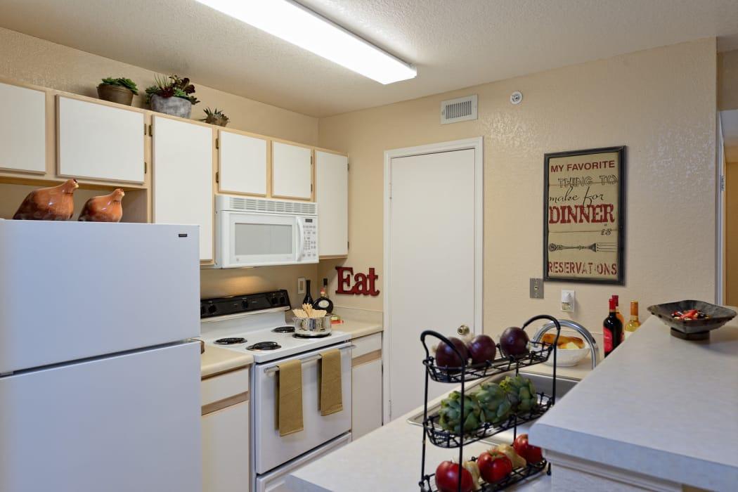 Fully equipped kitchen at Acacia Park Apartments in El Paso, Texas