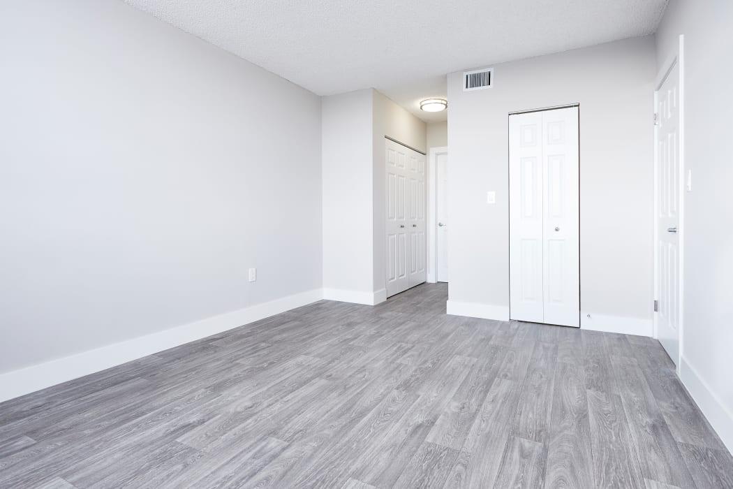 Spacious living area in open-concept floor plan of model home at Aliro in North Miami, Florida