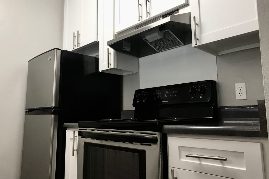 Renovated White kitchen with stainless steel appliances