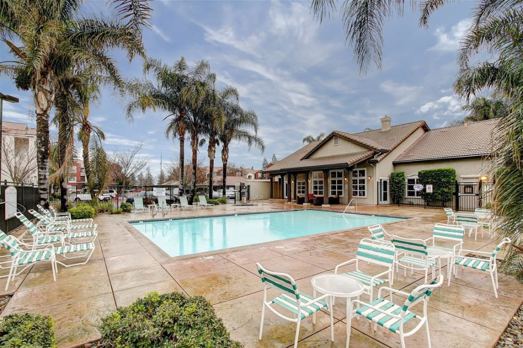 Palm trees around the swimming pool area at Eaglewood Apartments in Woodland, California
