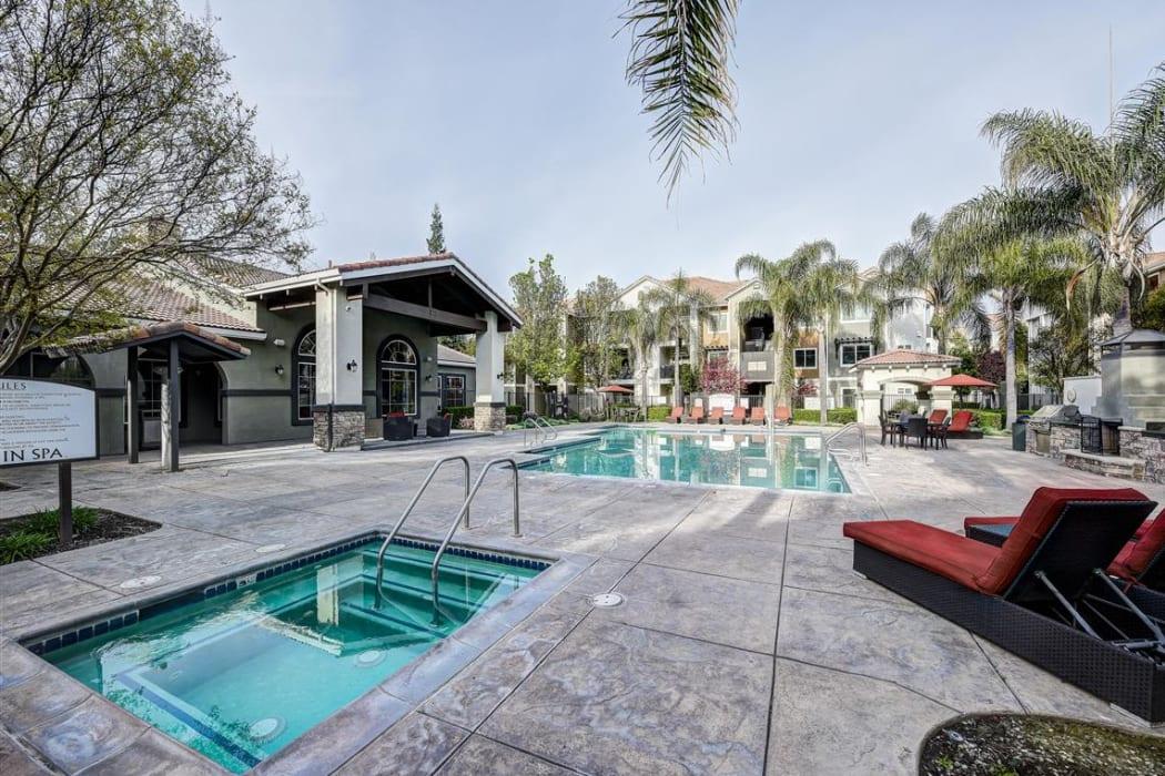 Spa and swimming pool area at Sierra Oaks Apartments in Turlock, California