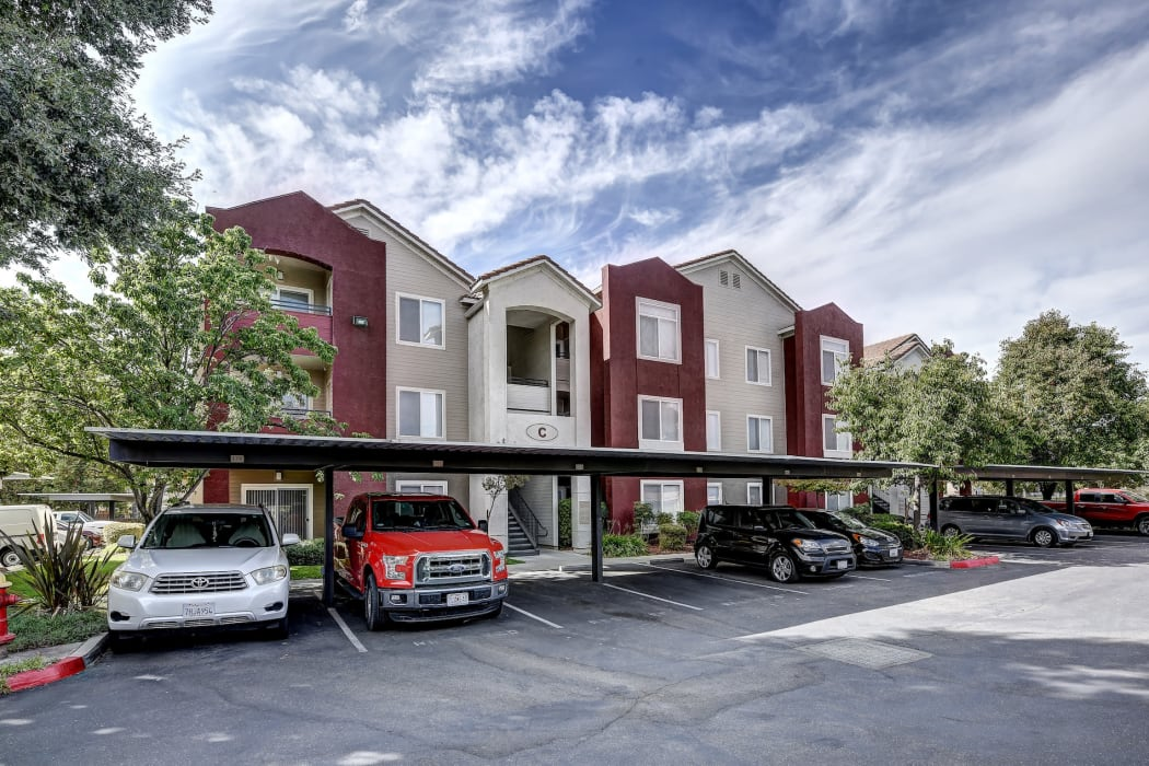 Exterior of apartments and covered parking at Eaglewood Apartments in Woodland, California