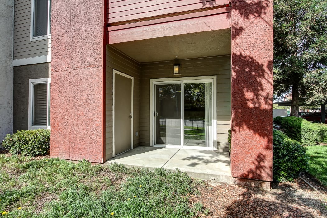 Back patio of apartment at Eaglewood Apartments in Woodland, California