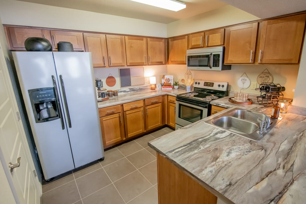 Kitchen with stainless steel appliances at Icon at Norman in Norman, Oklahoma