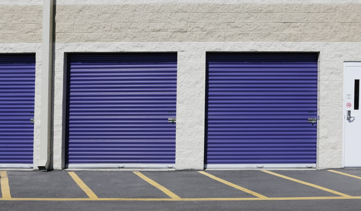 Units with blue doors at StoreSmart Self-Storage in Durham, North Carolina