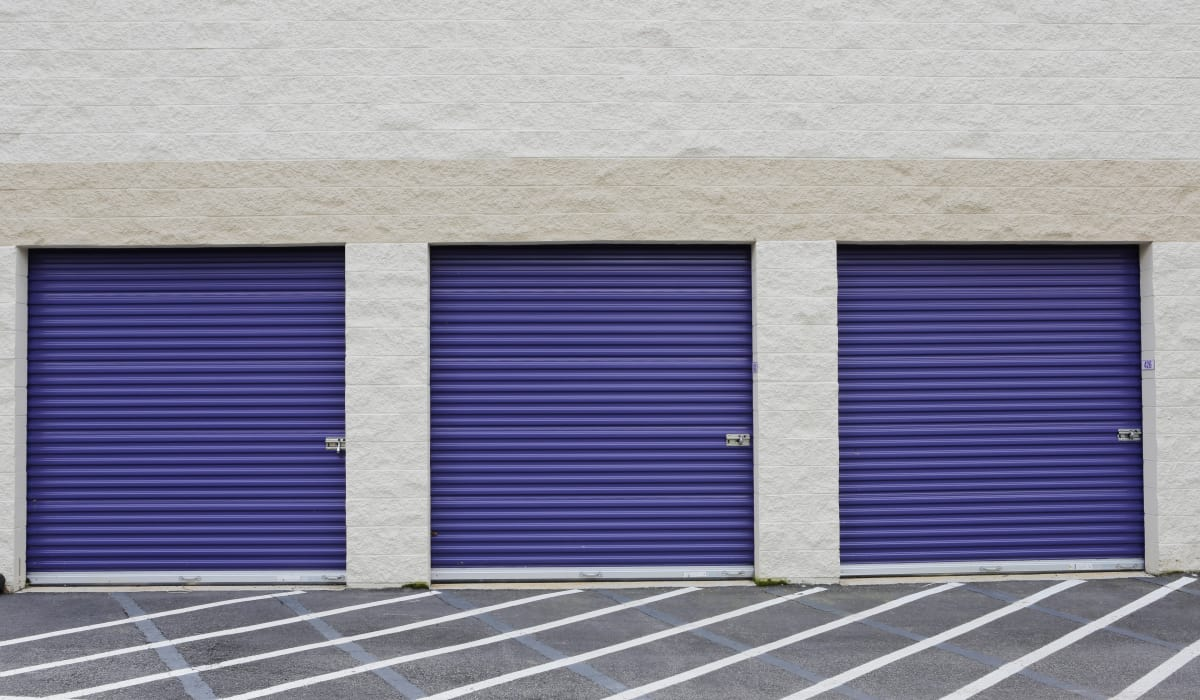 Blue roll-up doors at StoreSmart Self-Storage in Raleigh, North Carolina