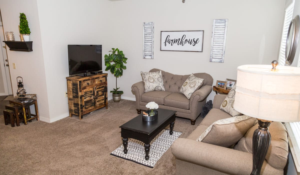 A spacious living room with plush carpeting at Traditions at Mid Rivers in Cottleville, Missouri