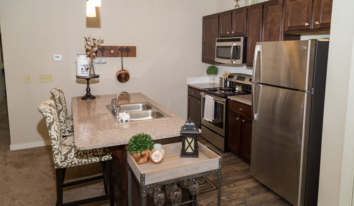 A kitchen with a breakfast bar at Traditions at Mid Rivers in Cottleville, Missouri