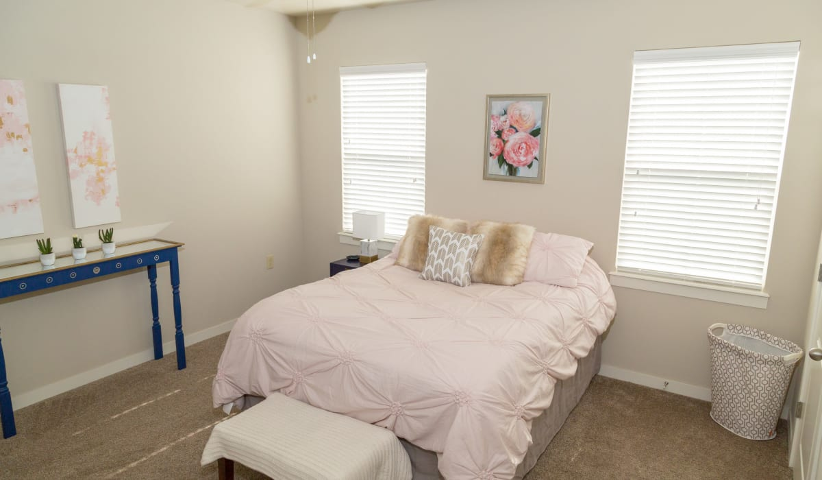 A large bedroom with two windows at Traditions at Mid Rivers in Cottleville, Missouri