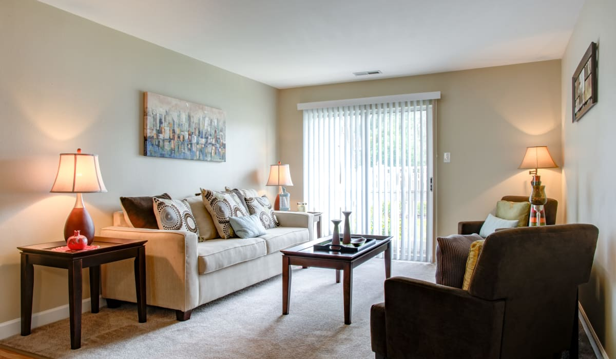 A living room with plenty space for comfortable seating at Greenway Chase in Florissant, Missouri