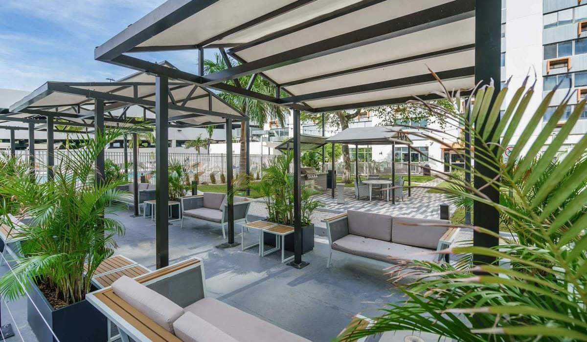 Plenty of shaded seating near the barbecue area at Our Property in St Petersburg, Florida