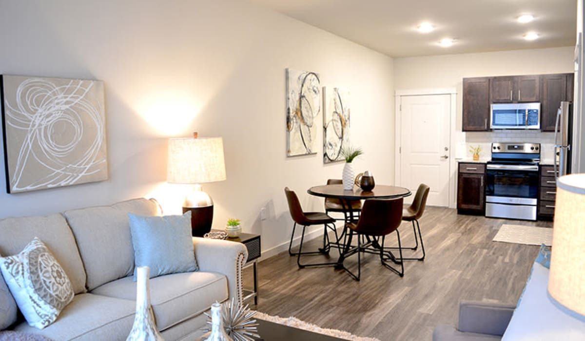 Open-concept layout with wood-style flooring at Pure St. Peters in Saint Peters, Missouri