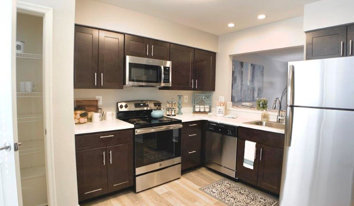 A kitchen with wood-style cabinets at Villas at Greenview West in Great Mills, Maryland
