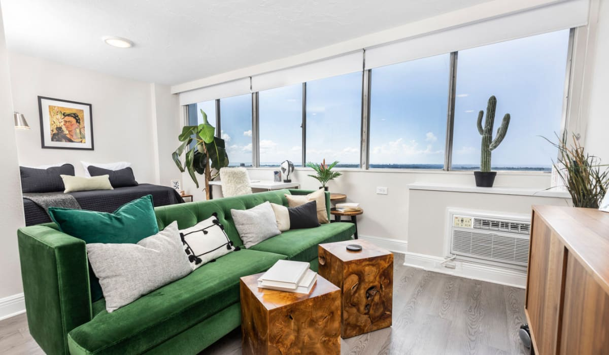 Modern decor in unit living room with plenty of natural light at The Wayland in St Petersburg, Florida