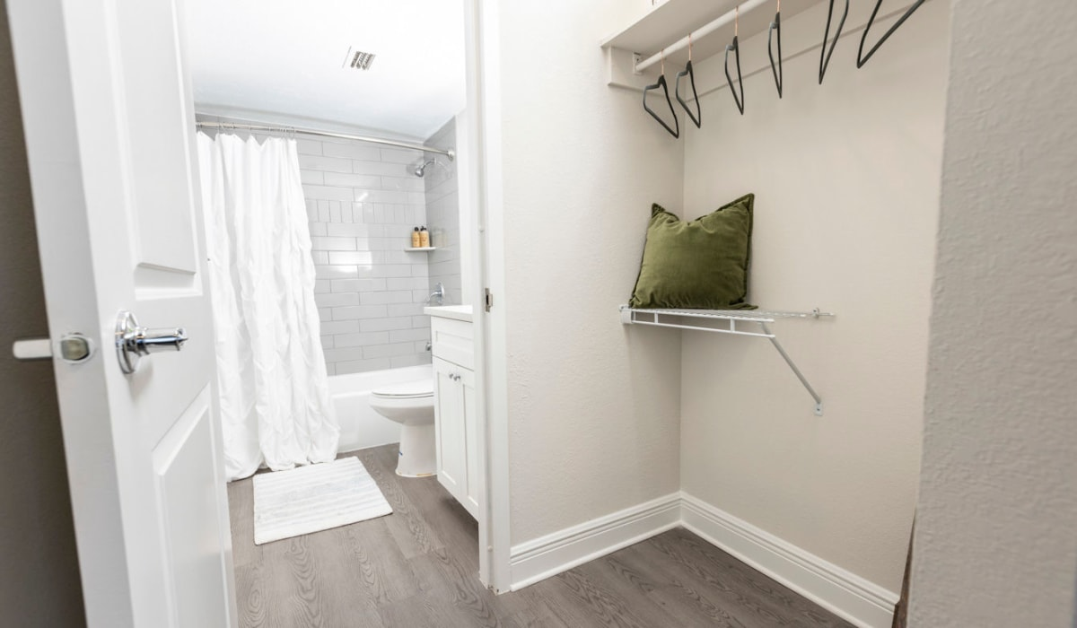Walk-in closet attached to bathroom at The Wayland in St Petersburg, Florida